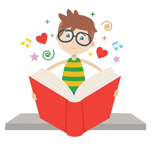 obrazek przedstawiający chłopca czytającego książkę