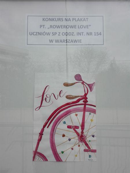 plakat wykonany przez ucznia: napis Love i rysunek roweru