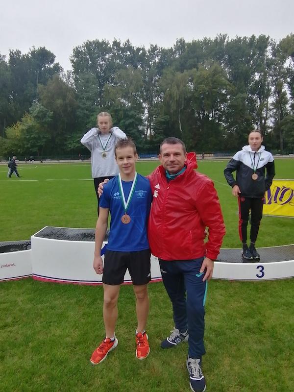 Brązowy medalista z trenerem